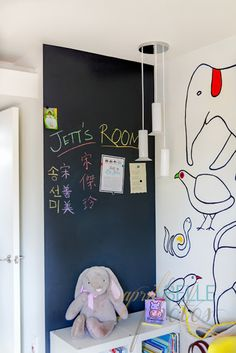 One chalkboard accent wall in the nursery.