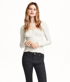 Fitted top in soft cotton jersey with a scoop neckline, buttons at front, and long sleeves.