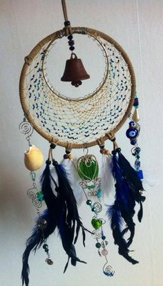 This is a one of a kind authentic Native American dream catcher. Its crescent shape is to honour the mother goddess, its sinew webbing is hand