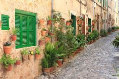 Old houses with flowers in the mediterranean village of Valldemossa, Mallorca