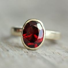 Garnet - my husband's birthstone!  This is similar to one I used to have, it was my favorite ring!!