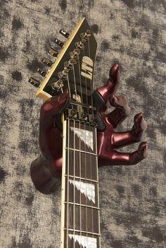 burgundy female hand shaped guitar wall mount. Made by GuitarGrip. #guitarhanger #homedecor #music #ltdguitar