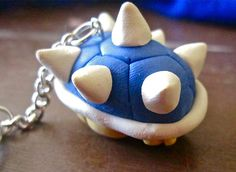 Arm yourself with the deadliest weapon in the Mario Kart universe when you carry around the blue shell keychain. This mercilessly deadly weapon can be detached...