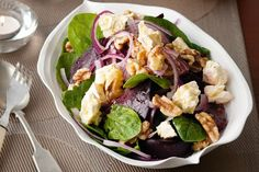 BEET & FETA SALAD 1 medium beetroot, roasted 50g baby spinach 1/2 small red onion, thinly sliced 75g feta cheese, crumbled 1/4 cup walnuts, lightly toasted 2 tablespoons orange juice 1 tablespoon olive oil 1/2 teaspoon dijon mustard