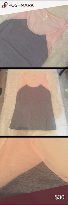 Lucy Mesh Yoga Tank Super soft work out Tank from Lucy yoga, grey cotton bottom with pink mesh detailing, breathes really well. Like new condition. Lucy Tops Tank Tops