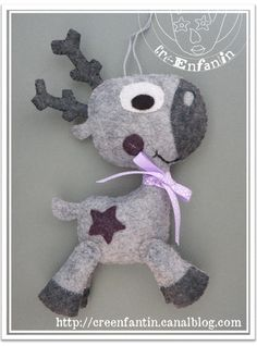 I can see this cute reindeer with a red nose and tan and brown felt...what a cute ornament it would be.  Felt is worry free for ornaments when the little ones are young!