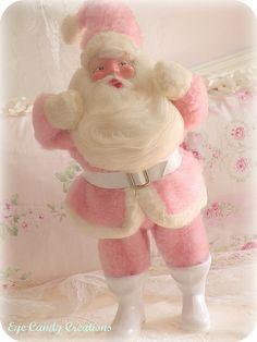 It's my pink Santa! I got this when I was only like 2 years old from my great aunts and uncle. When my mom wrapped it up and gave it to me 2 Christmas's ago, I cried a little. And now that I have my own home, he has a special place on my mantle.