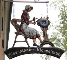 Wooden figure of a lacemaker in the main square of Oberwiensenthal, Saxony