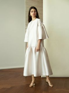 Bouguessa offers a very fashionable and stylish midi length ivory ruffled dress for a stylish winter bride