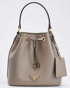 Prada saffiano leather bucket bag with golden hardware. Open top with drawstring closure. x x Made in Italy. Fall Handbags, Kate Spade Handbags, Hobo Handbags, Prada Handbags, Prada Bag, Black Handbags, Fashion Handbags, Purses And Handbags, Prada Purses