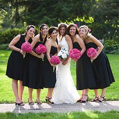 I love the idea of black bridesmaide dresses. Every girl can reuse a little black dress. I also like how not every dress is the same although the girl in the different dress is probably the maide of honor