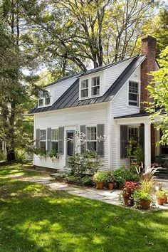 Farmhouse Touches - love the foliage and the windows upstairs!
