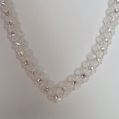 Gorgeous hand woven crystal, bead and rhinestone V necklace. Swarovski Crystals…