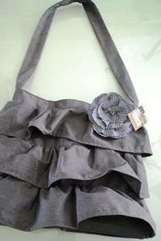 Skirt purse, find a skirt, a bag with a strap to go under it, and sew together , whala!