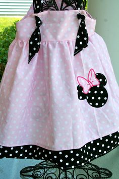 Minnie Mouse knot dress.  Pink, white and black with Minnie Mouse applique $30