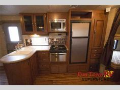 2016 New Forest River Rv Wildwood 28DBUD Travel Trailer in Texas TX.Recreational Vehicle, rv, 2016 Forest River RV Wildwood 28DBUD, The single slide Wildwood 28DBUD travel trailer by Forest River offers a rear bunk house and a u-dinette.To the left of the entrance there is a double kitchen sink, three burner range, microwave, refrigerator, and wardrobe with drawers. On the opposite side of the trailer there is a slide with a u-dinette and sofa. Along the front area of the living room, there…