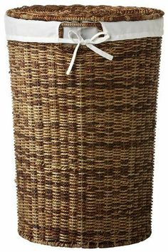 """Seagrass Round Laundry Laundry Clothes Hamper With Liner, 22Hx15.5Wx15.5D, DARK BROWN by Home Decorators Collection. $99.00. 22""""H x 15.5"""" diameter.. Hand crafted to perfection, our Seagrass Round Laundry Hamper will keep your bathroom in tip-top shape by having a place for dirty clothing. The removable, washable liner adds added functionality. Durable and easy to clean. Beautiful dark brown finish. Can also work as a bin for toys or shoes. Actual size is 22Hx15.5Wx15.5D"""