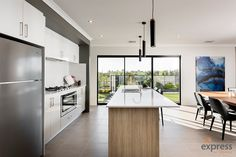 The open plan kitchen with lustrous island bench. Ventura Homes, Island Bench, Storey Homes, Display Homes, Open Plan Kitchen, House Design, Entertaining, Doors, Table