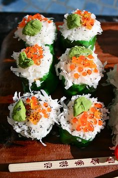"""SUSHI CAKE: This """"sushi roll"""" is actually sliced twinkles, wrapped in a green Fruit Roll-Up and topped with white icing and coconut. The Roe is gel icing and wasabi is colored fondant. Topped it off with a sprinkle of black sugar for the """"seeds""""."""