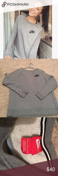Grey Nike sweater Comfortable grey Nike sweater! Only worn a couple of times. Perfect sweater for leggings or jeans on a casual hang out day 😊 Feel free to make an offer! Nike Tops Sweatshirts & Hoodies