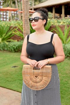 Girl With Curves blogger Tanesha Awasthi shares her tropical vacation must-haves.