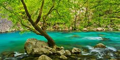 Crystal clear waters can be found not only in beaches but also in rivers such as Voidomatis, which is one of the cleanest rivers in Europe. This particular river is so clean that you can even drink its water. Mountain Village, Crystal Clear Water, Greece, Europe, Romantic, Beach, Places, Outdoor, Beautiful
