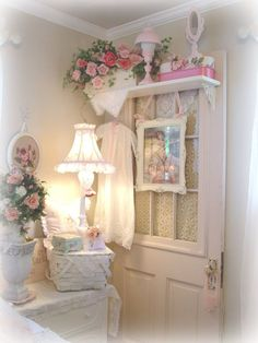 Shabby Chic pretties. I love the shelf on the door !