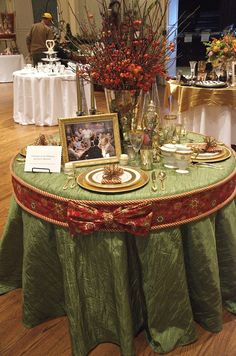 The band is pinned to the tablecloth.  It is edged with puffy cording; the bow is a separate piece. (several other holiday tablescapes in this post)
