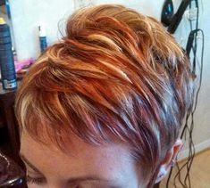 Womens short hair cut with red and blond highlights. Lowlights highlights pixie adorable texture.