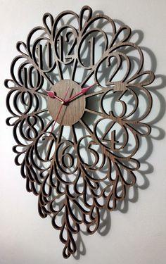 """De dimensiuni mari, (45 cm lungime) acest ceas da o nota moderna inspirata de natura, livingului tau.  Poate fi personalizat cu un mic text sub cifra """"6"""" pentru un plus de originalitate.  Dimensiuni: L=45 l=30 h=0.7 cm (la aceasta inaltime se adauga 1.5 cm reprezentand mecanismul ceasului)  Material: MDF superior furniruit sau vopsit in diverse culori (materialul si culorile difera in functie de stocul disponibil) Clock, Abstract, Wall, Modern, Home Decor, Watch, Summary, Trendy Tree, Decoration Home"""