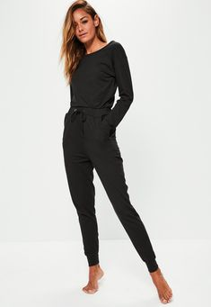 channel some serious casual chic vibes wearing this jumpsuit in black - featuring long sleeves, a rounded neckline and drawstring waist. Snap it up before we beat you to it!