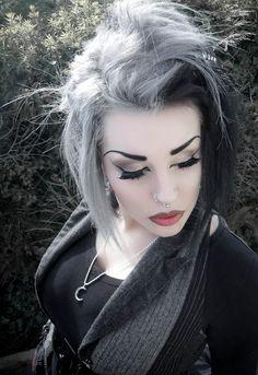 "Half light (grey-white-blonde), half dark (dark brown- black) ""alternative"" hair color and style"