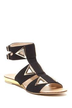 T-strap sandals with triangle accented hardware cutouts.
