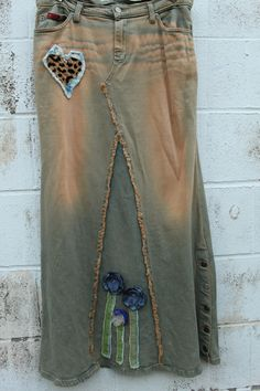 Jeans Skirt Upcycled via Etsy. Dont like the flower things just the skirt....