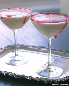 """Pink Ghoulada    For The """"Blood""""  3 tablespoons corn syrup  1/4 teaspoons red food coloring  For The Drink  20 ounces pineapple juice  1 can (15 ounces) cream of coconut  1/2 cup heavy cream  1 cup orange juice  10 ounces good-quality rum"""