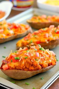 Twice Loaded Baked Sweet Potatoes - the perfect side dish for any meal. The sweet potatoes are packed with with a brown sugar and cinnamon filling and then topped with cheese, crispy bacon, and sour cream. It's filled with flavor and the perfect fall dish for when you want something warm and comforting!
