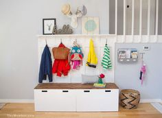 The secret to an organized home is never believing you have enough storage. Here, two storage benches serve an even greater purpose with the addition coat and bag hooks and a ledge shelf up top for adorable art. Get the tutorial at The Mombot »