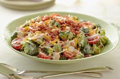 Cheddar-Chicken Crunch Salad recipe. 310 calories for 2 cup serving. You could easily cut calories more by using low-fat miracle whip, dressing and cheese