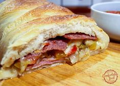 Stuffed with cheese, ham and salami this stromboli is over the top delicious. The onions and peppers add such great flavor and texture. It's a great dinn
