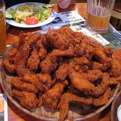 Make our Hooters Buffalo Chicken Wings Recipe at home for you next party or football game. Our Secret Recipe tastes just like Hooters' Wings I Love Food, Good Food, Yummy Food, Hooters Wings Recipe, Frango Chicken, Great Recipes, Favorite Recipes, Chicken Wing Recipes, Snacks