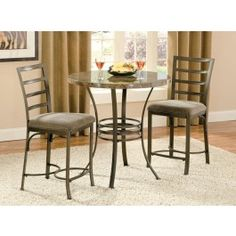 The Collison Collection features durable metal and a faux marble table top. This 3 piece set includes the Collison counter table and 2 counter chairs with upholstered seats. Table Size: 36H x 36D x 36W