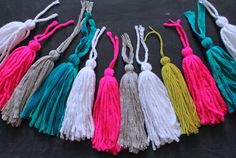 colored yarn tassels - This DIY project would look great as garland in the bird theme classroom!