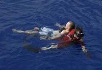 Coast Guard Swimmer Standards:  - Pushups - 100+ in 2:00   - Sit-ups - 100+ in 2:00   - Pull-ups - 15-20+   - 12:00 Swim - swim 500-750yd   - 1.5 mile run - sub 9:00   - 25 yd underwater swim - complete   - 200 yd Buddy tow - complete