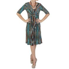 @Overstock - Cute with a funky print, this knit dress by Sangria features half sleeves and highlights a multi-colored print with a blue and brown color scheme. This fashionable dress is designed with comfortable fabric and a tailored fit that adorns stylish front tie.http://www.overstock.com/Clothing-Shoes/Sangria-Womens-Half-sleeve-Tie-front-Dress/7499471/product.html?CID=214117 $46.99