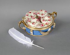 An early 19th. century Coalport porcelain deskpiece for four quills with four inkpots, holders and pounce pots made in about 1830