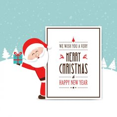 Happy santa claus holding a gift Free Vector
