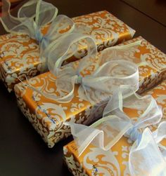 Designer wrapping paper like this gold damask is available in specialty shops like Hot Pink in Brentwood.