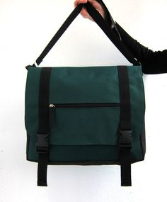 This is a stylish unisex messenger bag in trendy forest green color. It is made of water resistant fabric. Its large and roomy, and it also has many pockets, so you definately will find the right place for all your things.  Bag has a padded back and a padded section for your tablet or small laptop. It also has big zippered section at the back to keep your most precious things secure.  All the using parts of the bag are double or triple stitched. The bag is fully lined. Lining is made of rip…