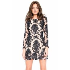 For Love & Lemons Lace Dress This dress is absolutely stunning! Long sleeve, nude and black lace. Open back. Fit and flare bottom. So stunning and romantic! Never worn, new with tags. For Love and Lemons Dresses Long Sleeve