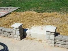 Miniature cobblestone columns add architectural design to the landscaping.